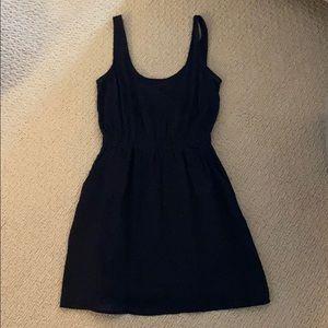 Black dress in grid texture
